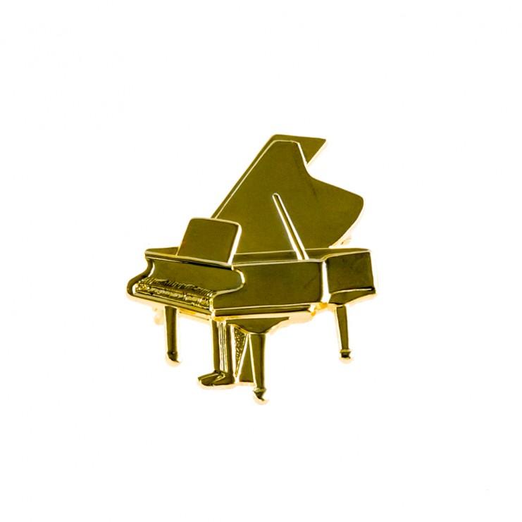 Broche dorado piano